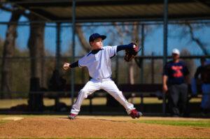 child throwing baseball