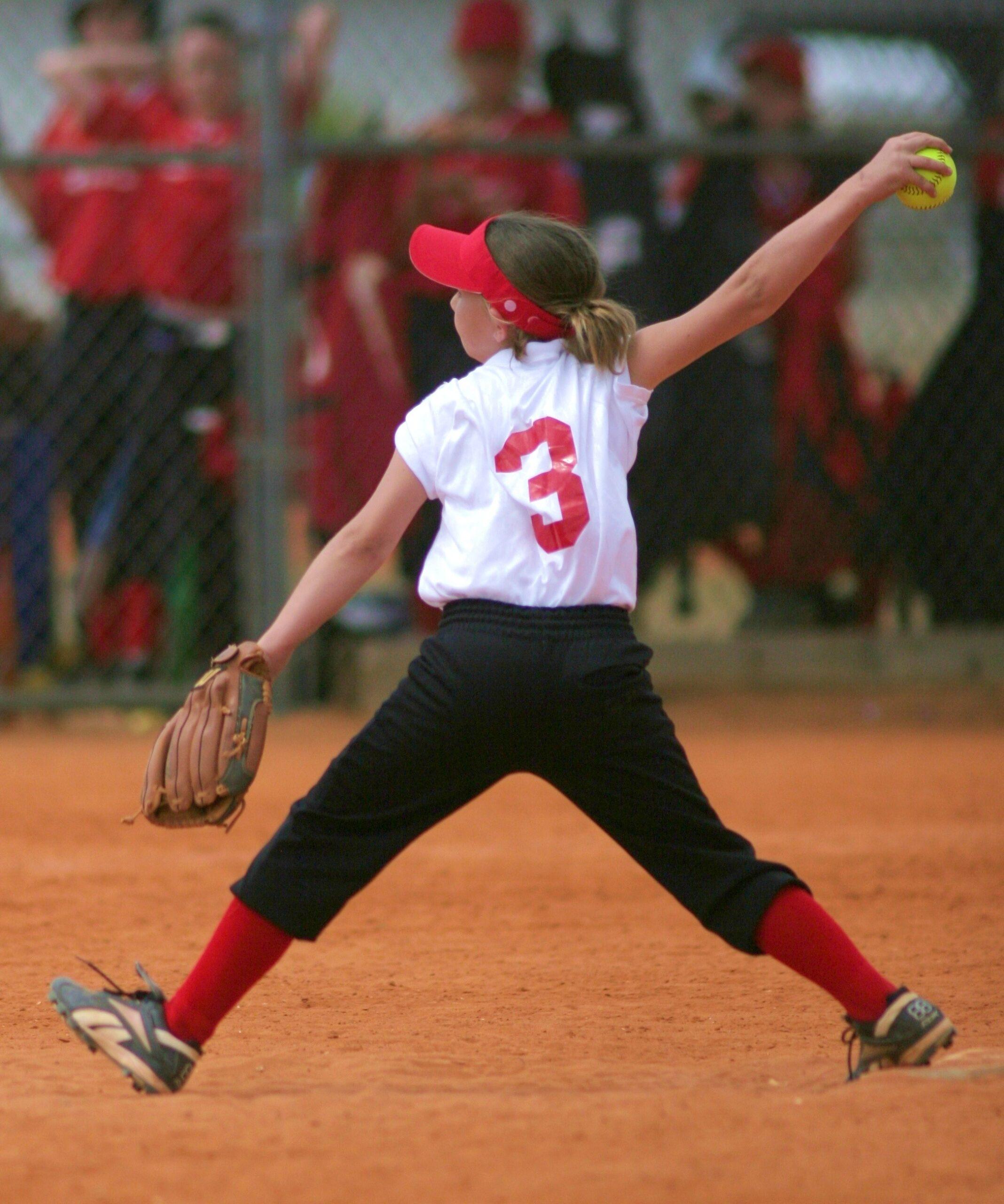 young girl pitching softball